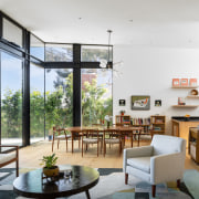The interiors blend the rational approach of Mid-century