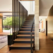 This three-storey stair separates the entertaining spaces from architecture, building, ceiling, floor, flooring, handrail, home, house, interior design, lobby, property, real estate, room, stairs, brown, white