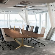 A large 7.5 metre-long walnut table accommodates visitors architecture, building, ceiling, chair, conference hall, design, desk, floor, flooring, furniture, house, interior design, office, office chair, room, table, white, gray