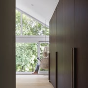 A bank of dark-toned wood cabinetry contrasts the