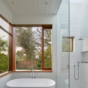 A large skylight above the shower and a