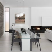 Blonde wood floors, white cabinetry and black fireplace
