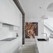 Giant paintings break up expansive walls of white,