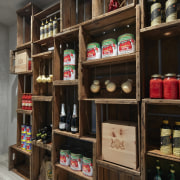 The pantry, clad in timber board, divides the