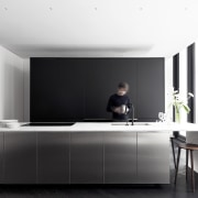The kitchen is as pared back and minimalist
