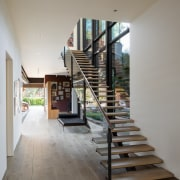 In the home's generous entryway, glass and steel