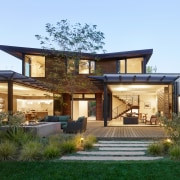 The butterfly roof gives the house its distinctive