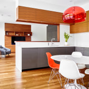 A translucent pendant in the kitchen mirrors the