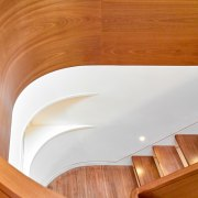 The central staircase is crafted of solid mahogany