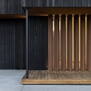 Timber fixed louvres set in front of opaque