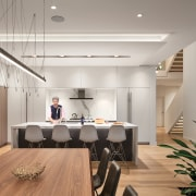 Kitchen and dining rooms with open staircase in