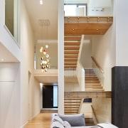An open stair runs through the centre of