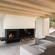 An almost industrial strength fireplace is a visual