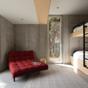 Raw concrete connects with the rock tones outside