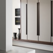 Built-in millwork, combining walnut, lacquered wood and custom