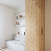 Cabinetry becomes room divider in the innovative design.