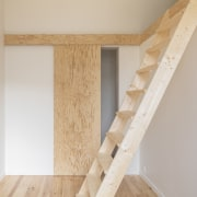 A wood stair accesses a harder to reach
