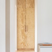 Here cabinetry doors combine to echo the apartment's