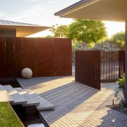 For this home landscape by Lutsko Associates, the brown