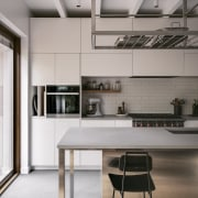 The crisp, light-filled kitchen was also designed from