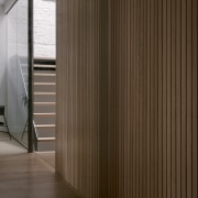 Wood-panelled screens of Japanese influence punctuate the sequences