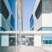 Mirrored facade elements add to the complex yet