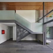 Frosted glass balustrades on the feature stair give