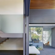 A sculptural stair inside and cantilevered concrete benches