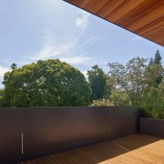 The upper floor deck with wood underfoot and