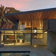 Dusk and the home's lighting accentuates features such