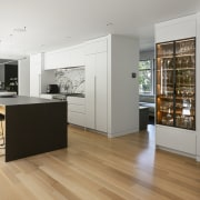 The substantial kitchen island is accompanied by a