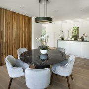 Natural materials feature throughout the renovated home's warm,