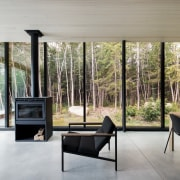 The effect of the floor-to-ceiling reflective glazing is