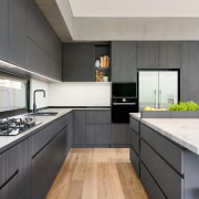 Recessed cabinetry pulls add to the kitchen's minimalist,