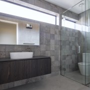 Cantilevering the vanity adds to the sense of
