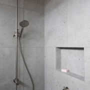 A shallow, recessed soap niche in the custom