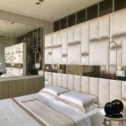 On the upper floor, the master bedroom is