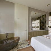 Opulent materials in the bedroom are continued on