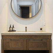 Another bathroom, another cabinet configuration and different mirror