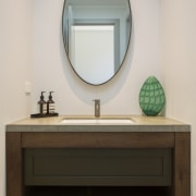 The powder room in the home follows a