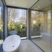 The clean, pared back bathing area gives the