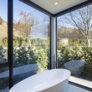 A comfortable tub, underfloor heating and giant windows