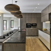 The dark wood toned cabinetry is complemented by