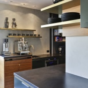 The kitchen includes a wealth of display shelving.