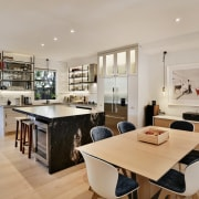 There's a seamless flow from the kitchen space countertop, interior design, kitchen, property, real estate, gray