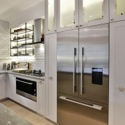 The new kitchen has more efficient food storage cabinetry, countertop, cuisine classique, home appliance, interior design, kitchen, major appliance, refrigerator, gray
