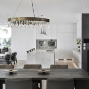 The kitchen, surrounded by large open areas, was
