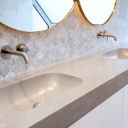 Corian Natural Grey sinks are at one with architecture, bathroom, bathroom sink, countertop, floor, flooring, granite, interior design, marble, plumbing fixture, property, room, sink, tap, tile, wall, gray