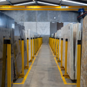 Universal Granite – row upon row of gleaming aisle, architecture, building, infrastructure, line, transport, wall, yellow, gray