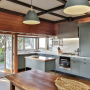 This seaside kitchen, by Kitchens by Design, results architecture, building, cabinetry, ceiling, countertop, cuisine classique, floor, furniture, hardwood, home, house, interior design, kitchen, loft, plywood, property, real estate, room, wood, wood flooring, wood stain, gray, brown